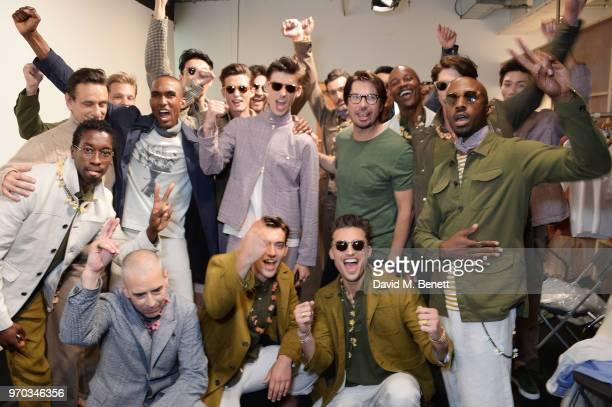 Designer Oliver Spencer poses with models backstage at the Oliver Spencer Catwalk Show SS 2019 during London Fashion Week Men's June 2018 at 180 The...