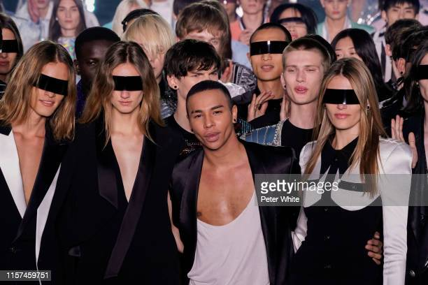 Designer Olivier Rousteing acknowledges the applause of the public after the Balmain Homme Menswear Spring Summer 2020 show as part of Paris Fashion...