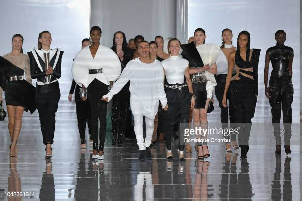 Designer Olivier Rousteing and model Cara Delevingne are applauded on the runway during the Balmain show as part of the Paris Fashion Week Womenswear...