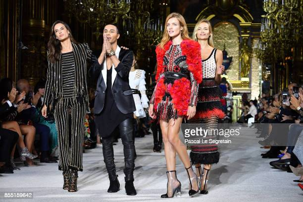 Designer Olivier Rousteing and models Alessandra AmbrosioNatalia Vodianova and Natasha Poly walk the runway during the Balmain show as part of the...