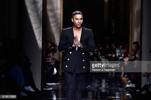 Designer Olivier Rousteing walks the runway during the Balmain show as part of the Paris Fashion Week Womenswear Fall/Winter 2016/2017 on March 3...