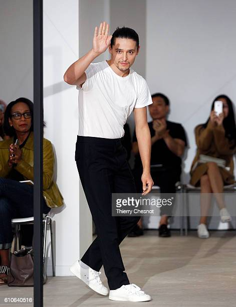 Designer Olivier Theysen acknowledges the audience at the end of his Womenswear Spring/Summer 2017 show on September 27, 2016 in Paris, France.