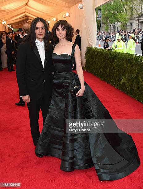 """Designer Olivier Theyskens and actress Felicity Jones attend the """"Charles James: Beyond Fashion"""" Costume Institute Gala at the Metropolitan Museum of..."""