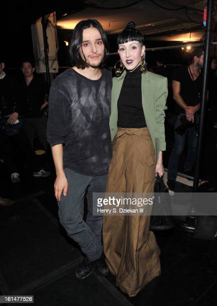 Designer Olivier Theyskens and Michelle Harper attend Theyskens' Theory during Fall 2013 Mercedes-Benz Fashion Week at Skylight Studios at Moynihan...