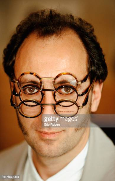 Designer Optician Alain Mikli Wearing Glasses