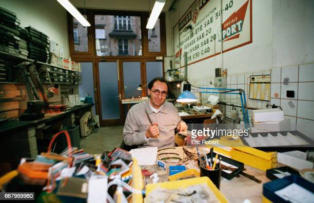Designer optician Alain Mikli works on a pair of glasses at his workshop in Paris