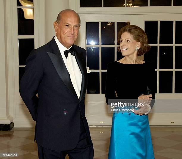 Designer Oscar de la Renta and his wife Annette De La Renta ViceChairman of the Metropolitan Museum of Art walk through the Booksellers room in the...