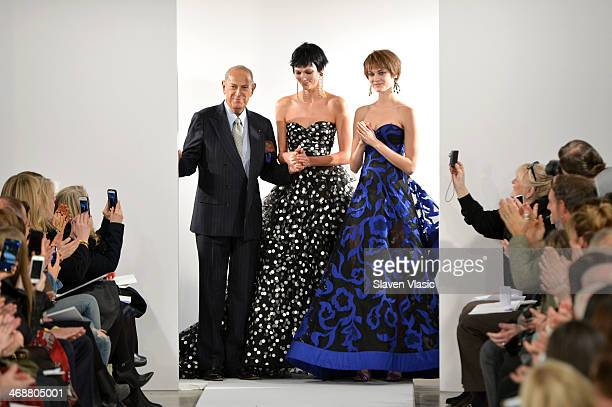Designer Oscar De La Renta and Model Karlie Kloss pose on the runway at the Oscar De La Renta fashion show during MercedesBenz Fashion Week Fall 2014...