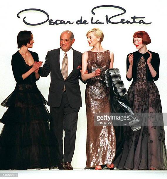 Designer Oscar de la Renta greets some of his models 10 April in New York at the end of his 1997 Fall fashion show The fashion shows continue through...