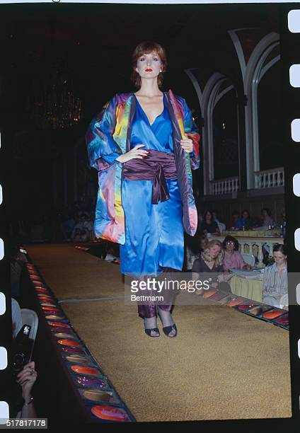Designer Oscar de la Renta offers for evening this big-sleeved jacket worn over dress which is worn over pants. Ensemble is part of his Fall-Winter...