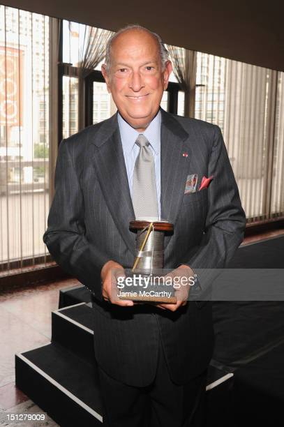 Designer Oscar de la Renta poses with his award at the 2012 Couture Council for the Museum at FIT Award for Artistry of Fashion to Oscar de la Renta...