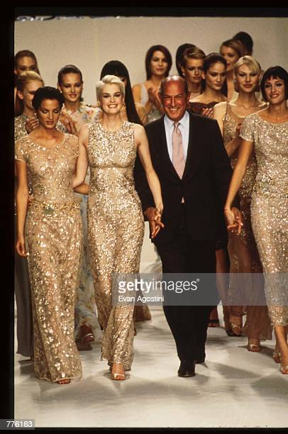 Designer Oscar de la Renta walks with models at the presentation of his Spring 1997 collection at the 7th on Sixth Fashion Shows October 31 1996 in...