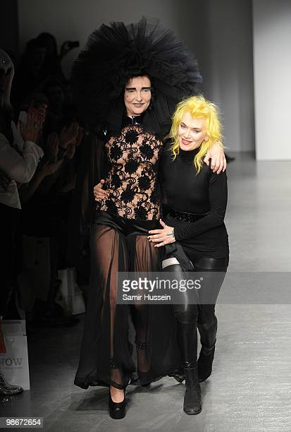 Designer Pam Hogg and a model walk the catwalk during the Pam Hogg show during London Fashion Week Autumn/Winter 2010 at On|Off at Senate House on...