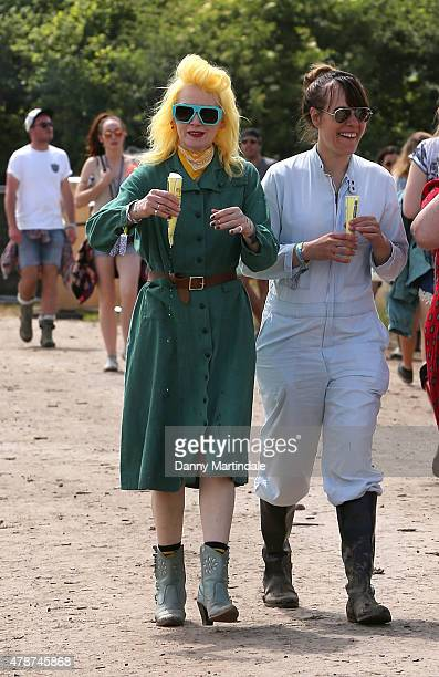 Designer Pam Hogg enjoys an icecream at the Glastonbury Festival at Worthy Farm Pilton on June 27 2015 in Glastonbury England