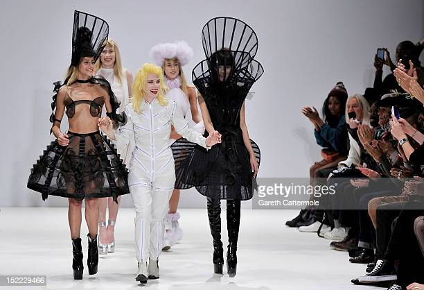 Designer Pam Hogg walks on the catwalk by Pam Hogg on day 4 of London Fashion Week Spring/Summer 2013 at the Freemasons' Hall on September 17 2012 in...