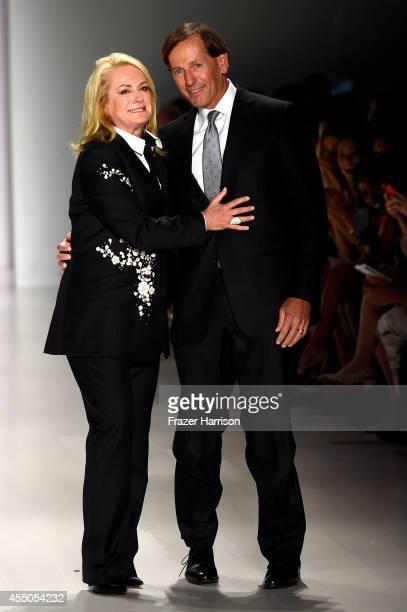 Designer Pamella Roland and her husband Daniel DeVos walk the runway at the Pamella Roland fashion show during MercedesBenz Fashion Week Spring 2015...