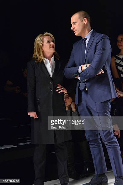 Designer Pamella Roland and photographer Nigel Barker watch rehearsal during the Pamella Roland Show during MercedesBenz Fashion Week Fall 2014 at...