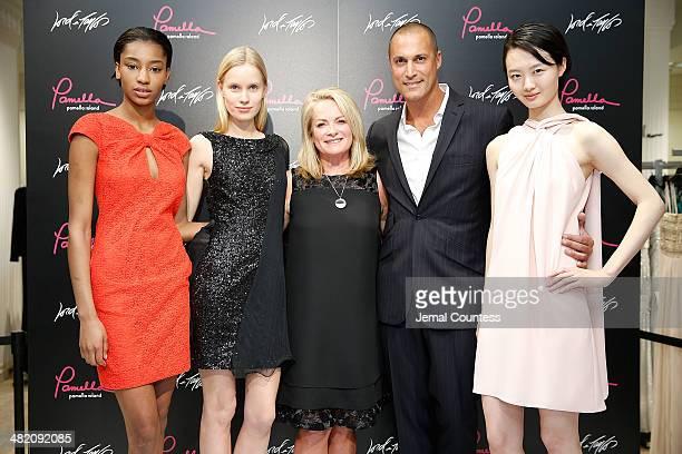Designer Pamella Roland and photographer/media personality Nigel Barker pose with models wearing Pamella Pamella Roland during The Launch Of Pamella...