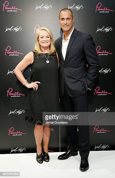 Designer Pamella Roland and photographer/media personality Nigel Barker attend the Launch Of Pamella Pamella Roland With Pamella Roland And Nigel...