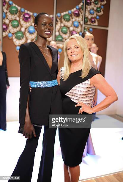 Designer Pamella Roland poses with model Ajak Deng at the Pamella Roland Resort 2017 Presentation at Bulgari Fifth Avenue on June 8 2016 in New York...