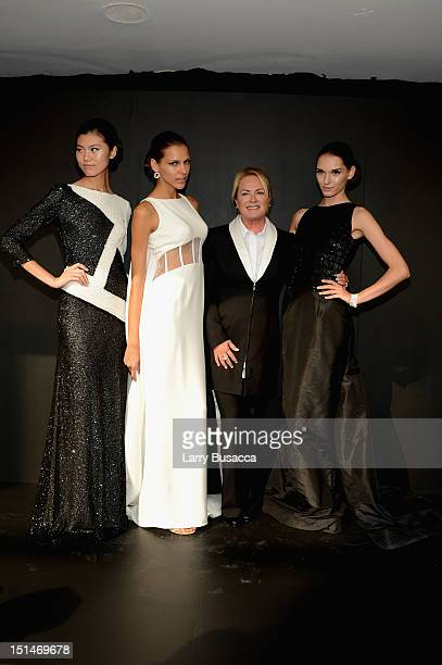 Designer Pamella Roland poses with models at the Pamella Roland Spring 2013 fashion show presentation during MercedesBenz Fashion Week at Avery...