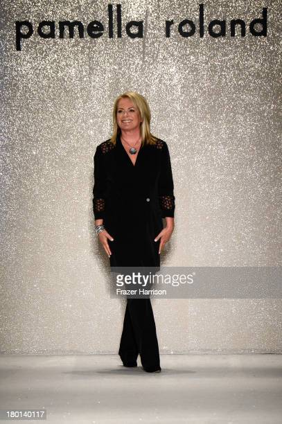 Designer Pamella Roland takes a bow on the runway at the Pamella Roland fashion show during MercedesBenz Fashion Week Spring 2014 at The Studio at...