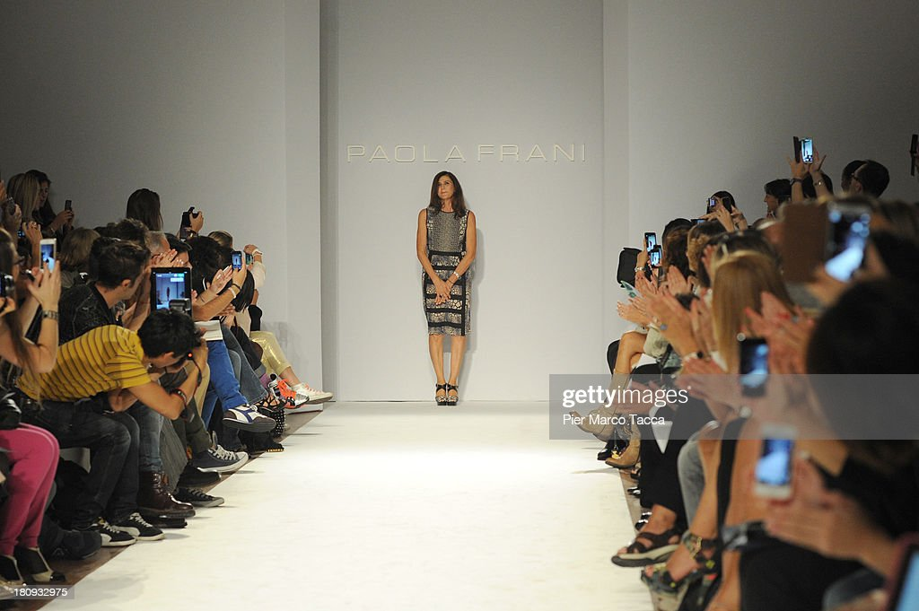 Designer Paola Frani acknowledges the applause of the audience on the runway at the Paola Frani show as a part of Milan Fashion Week Womenswear Spring/Summer 2014 on September 18, 2013 in Milan, Italy.