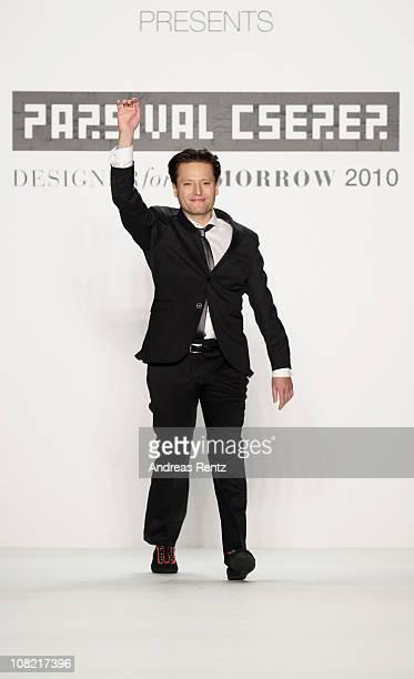 Designer Parsival Cserer walks the runway after the Parsival Cserer Show winner of 'Designer for tomorrow 2010' presented by Peek Cloppenburg during...
