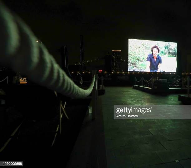 """Designer Patrick Robinson speaks during the private outdoor screening of """"The Times of Bill Cunningham"""" at Pier 17 on August 31, 2020 in New York..."""