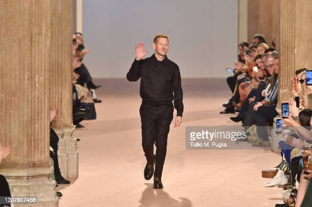 Designer Paul Andrew acknowledges applause of the audience during the Salvatore Ferragamo fashion show as part of Milan Fashion Week Fall/Winter...