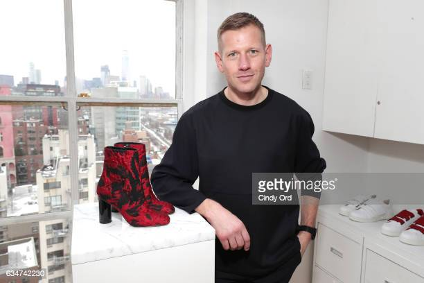 Designer Paul Andrew poses at the Paul Andrew collection during New York Fashion Week The Shows at Ramscale Studio on February 11 2017 in New York...