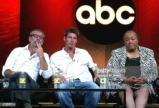 """Designer Paul DiMeo, Carpenter Ty Pennington, and Recipient """"Sweet"""" Alice Harris of """"Extreme Makeover: Home Edition"""" speak with the press at the ABC..."""