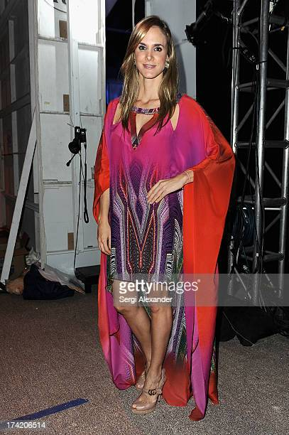 Designer Paula Saavedra poses backstage at the Caffe Swimwear show during MercedesBenz Fashion Week Swim 2014 at Oasis at the Raleigh on July 21 2013...