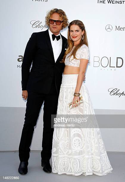 Designer Peter Dundas and Eugenie Niarchos arrive at the 2012 amfAR's Cinema Against AIDS during the 65th Annual Cannes Film Festival at Hotel Du Cap...
