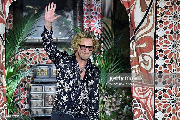 Designer Peter Dundas greets the audience at the end of the show for fashion house Roberto Cavalli during the 2017 Women's Spring / Summer...