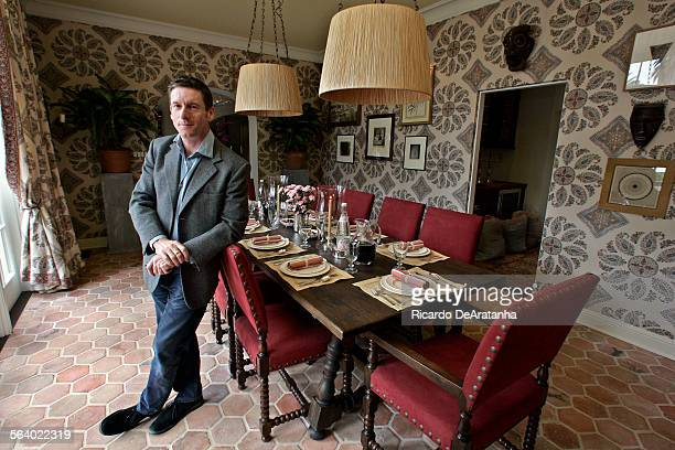 Designer Peter Dunham posing in living room he designed for House Beautiful a collaboration of 21 top interior and landscape designers who have...