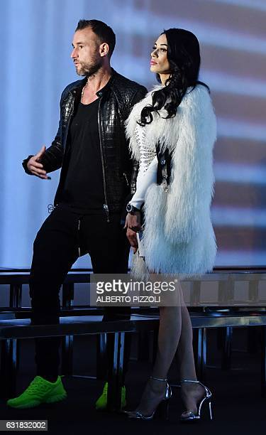 Designer Philipp Plein and girlfriend Andreea Sasu attend the show for fashion house Billionaire during the Men's FallWinter 20172018 fashion week on...
