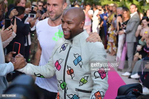 Designer Philipp Plein Boxer Floyd Mayweather Jr attends the/walks the runway at the Philipp Plein Cruise Show 2018 during the 70th annual Cannes...