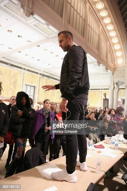 Designer Philipp Plein preps models before the Philipp Plein collection during New York Fashion Week The Shows at New York Public Library on February...