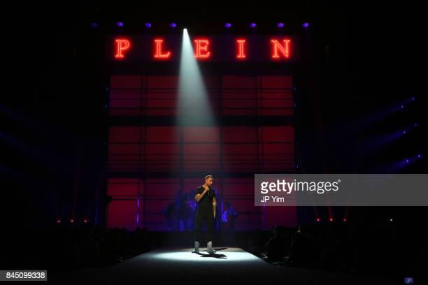 Designer Philipp Plein speaks on the runway at the Philipp Plein fashion show during New York Fashion Week The Shows at Hammerstein Ballroom on...