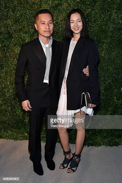 Designer Phillip Lim and model Xiao Wen Ju attend the 11th annual CFDA/Vogue Fashion Fund Awards at Spring Studios on November 3, 2014 in New York...