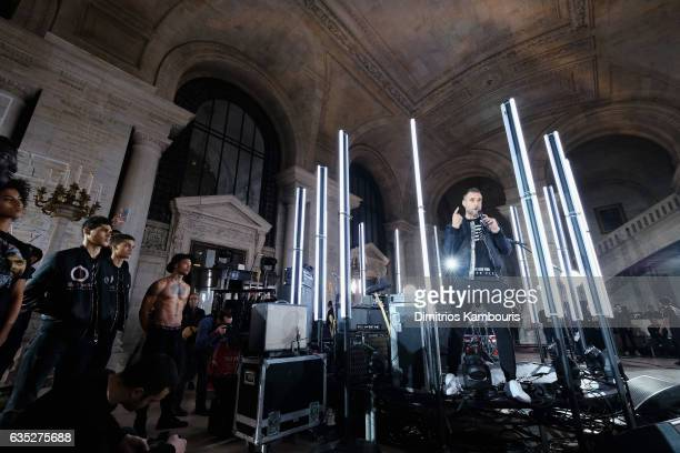 Designer Phillipp Plein addresses the models backstage for the Philipp Plein Fall/Winter 2017/2018 Women's And Men's Fashion Show at The New York...