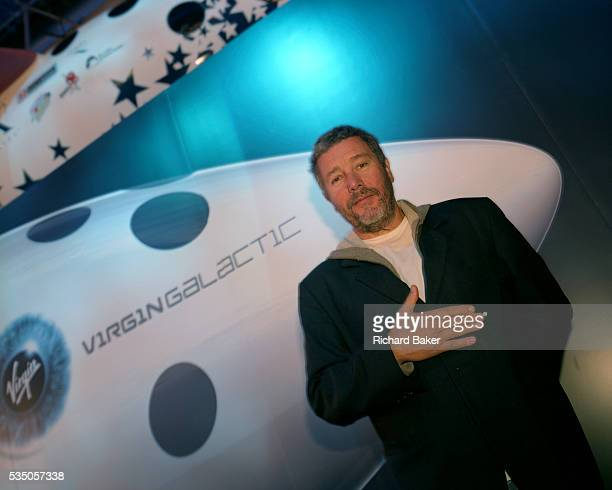 Designer Phillippe Starck standing at the nose of Virgin Galactic's SpaceShipTwo during its unveiling at the New York Wired NextFest at the Jacob K....
