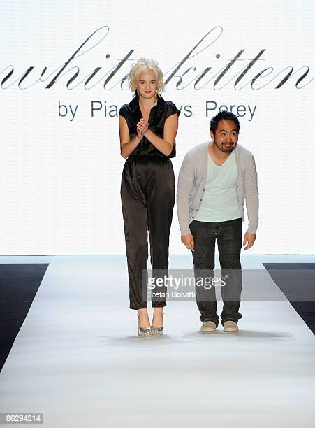 Designer Pia Gladys Perey appears on stage with a model following his White Kitten catwalk show at the Women's Ready To Wear 2 show at The Overseas...