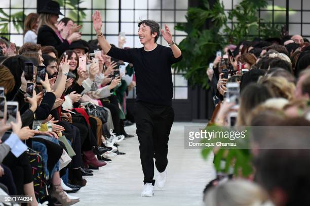 Designer Pierpaolo Piccioli acknowledges the applause of the audience after the Valentino show as part of the Paris Fashion Week Womenswear...