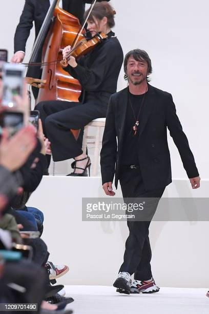 Designer PierPaolo Piccioli walks the runway during the Valentino as part of the Paris Fashion Week Womenswear Fall/Winter 2020/2021 on March 01,...