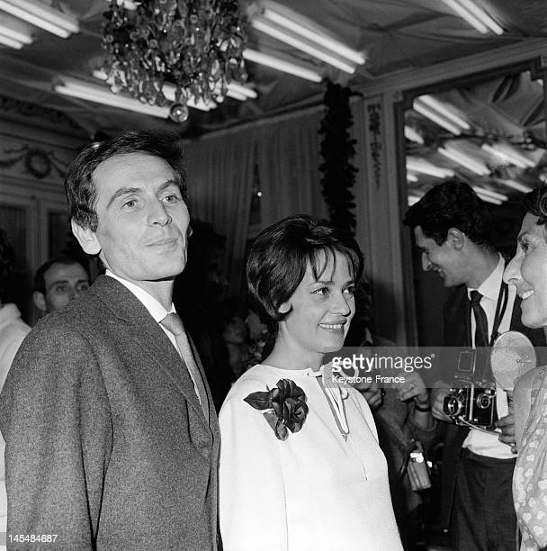 Designer Pierre Cardin congratulated by actress Jeanne Moreau after his fashion show on July 27 1963 in Paris France