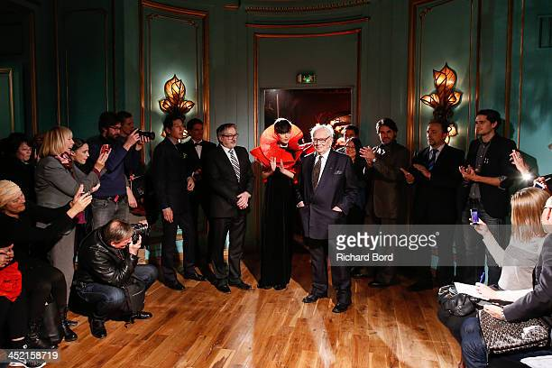Designer Pierre Cardin pose with a model and his staff during the Pierre Cardin Paris Haute Couture New Collection launch at Maxim's on November 26...