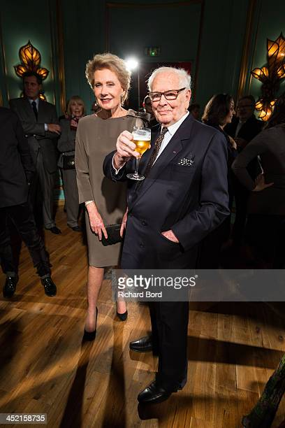Designer Pierre Cardin poses with Elisa Servier during the Pierre Cardin Paris Haute Couture New Collection launch at Maxim's on November 26 2013 in...