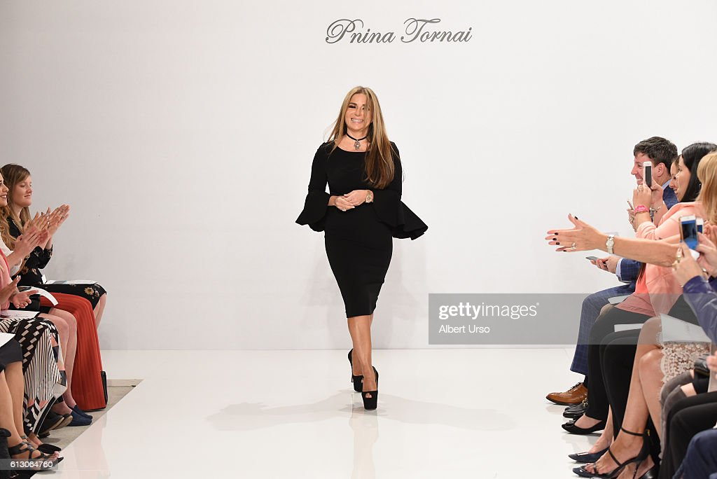 Designer Pnina Tornai walks the runway at the Pnina Tornai For Kleinfeld show during New York Fashion Week: Bridal at Kleinfeld on October 6, 2016 in New York City.